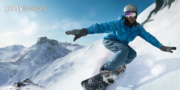 Close Up Snowboarder Moving At High Speed Down Mountain Slope - gettyimageskorea