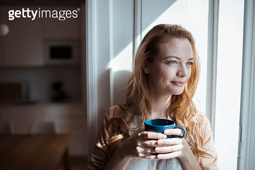 Young woman having a cup of coffee - gettyimageskorea