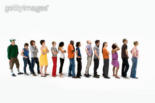 Men and women standing in a line - gettyimageskorea