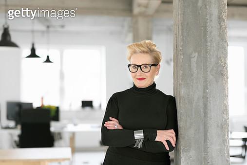 Portrait of elegant senior businesswoman in the modern studio - gettyimageskorea