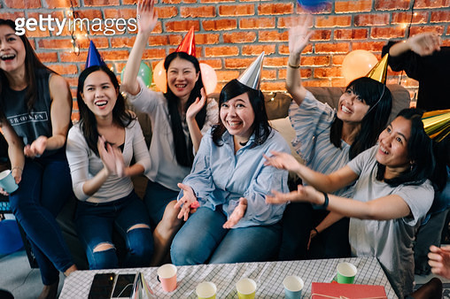 Group of Friends Playing Balloon at Birthday Party - gettyimageskorea