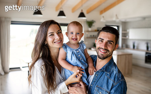 Father, mother and lilttle daughter in living room. - gettyimageskorea
