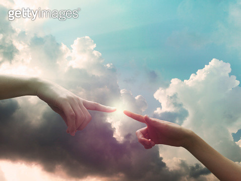 Two hands are connecting in the sky - gettyimageskorea