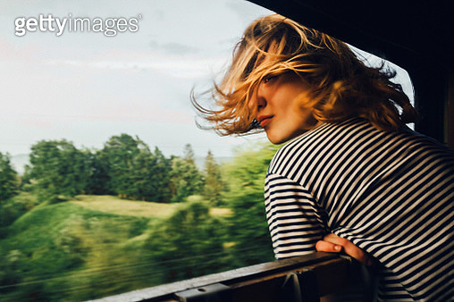 Woman looking at the view from train - gettyimageskorea