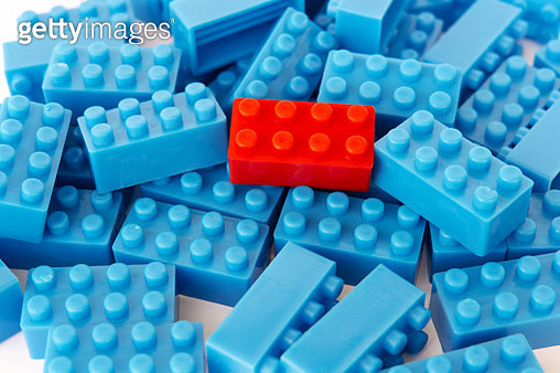 Stack Of blue toy Blocks and one red block - gettyimageskorea