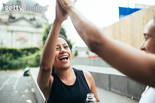 Two women giving high five after workout. - gettyimageskorea
