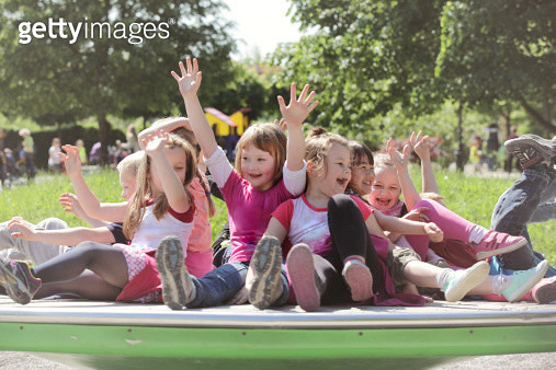 Lively kindergarteners invading the playground - gettyimageskorea