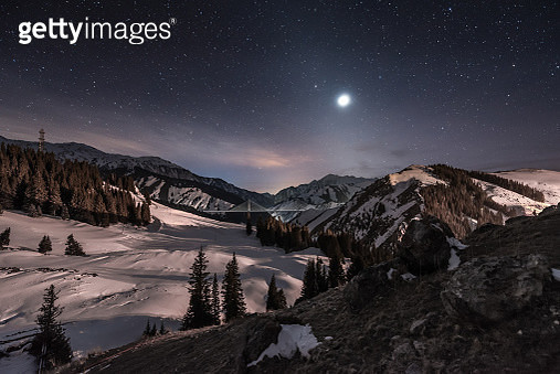 Hills in snow at night, Xinjiang Province, China - gettyimageskorea