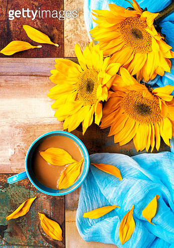 Composition of sunflowers and a cup of coffee - gettyimageskorea