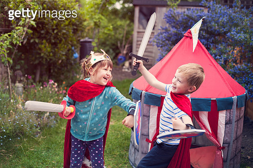 Girl and boy play fighting - gettyimageskorea