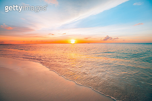 Sunset sea landscape. Colorful ocean beach sunrise. Beautiful beach scenery with calm waves and soft sandy beach. Empty tropical landscape, horizon with scenic coast view. Colorful nature sea sky - gettyimageskorea
