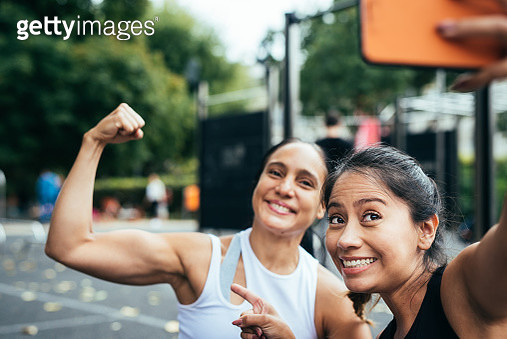Women having fun while doing a selfie after fitness. - gettyimageskorea