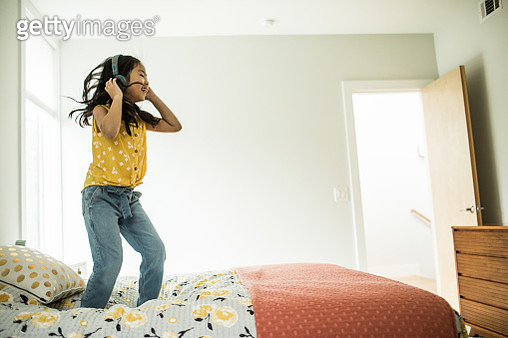 Young girl (6 yrs) using headphones and tablet at home - gettyimageskorea