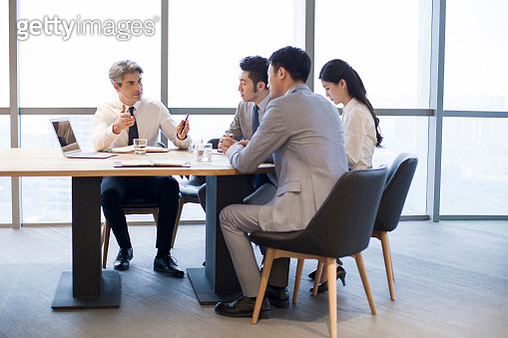 Business people having meeting in board room - gettyimageskorea