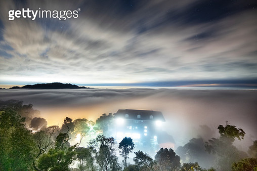 Flowing sea of clouds at sunset - gettyimageskorea