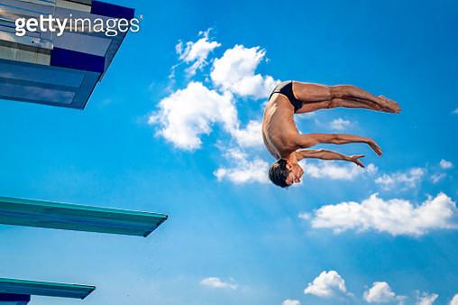 Springboard diver in mid-air - gettyimageskorea