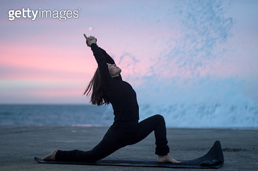 spanish girl practicing yoga when sunrise by the beach in Barcelona - gettyimageskorea