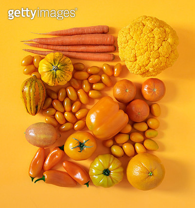 Looking down on monochrome orange fruits and vegetables - gettyimageskorea