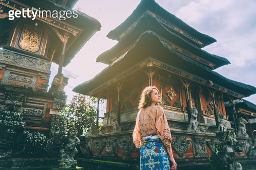 Woman walking in Balinese temple - gettyimageskorea