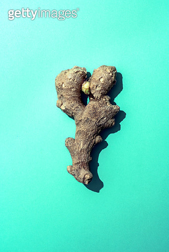 A piece of ginger on colored background - gettyimageskorea