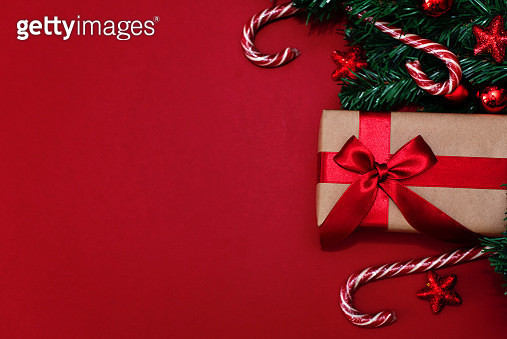 Christmas gifts presents on red background. Simple, classic red and white wrapped gift boxes with ribbon bows and festive holiday decorations. - gettyimageskorea