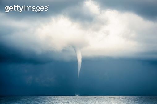 Cloud Typologies: Tornado, Hurricane, Cyclone, Typhoon, Cumulus Clouds in moody Sky during Sumer Monsoon Thunder Storm. - gettyimageskorea