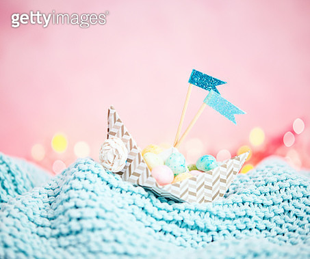 Handmade origami boat filled with tiny Easter eggs - gettyimageskorea