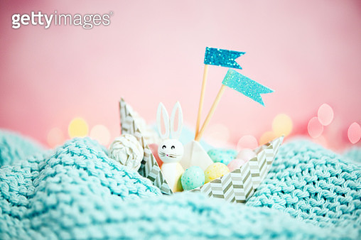 Handmade origami boat filled with tiny Easter eggs and Easter bunny - gettyimageskorea