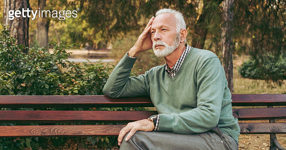 Senior man sitting on bench in the park - gettyimageskorea
