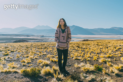 Young Caucasian woman on the background of  scenic view of lake in Atacama desert, Chile - gettyimageskorea