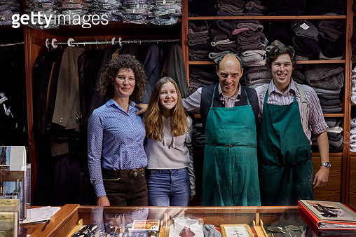 Portrait of smiling family in a tailor shop - gettyimageskorea