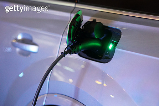 Close-Up Of Car At Electric Vehicle Charging Station - gettyimageskorea