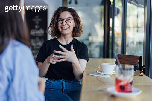 Two young woman speak in sign language - gettyimageskorea