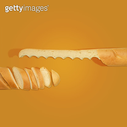 Bread knife made out of bread with a sliced loaf of bread on a yellow background. - gettyimageskorea