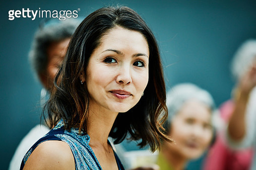 Portrait of smiling mature woman at family dinner party in backyard - gettyimageskorea