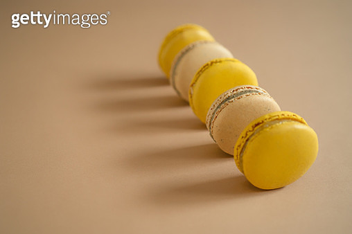 High Angle View Of Macaroons Arranged On Brown Background - gettyimageskorea