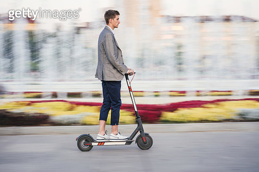 Young man riding e-scooter in the city - gettyimageskorea