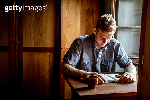 Young Adult Man Reading a Book - gettyimageskorea