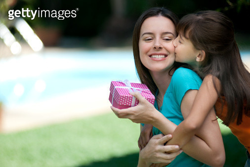 Mother receiving a gift from her daughter - gettyimageskorea