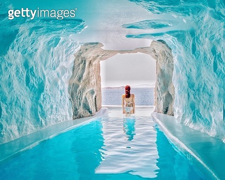 Rear View Of Woman Standing At Beach Seen Through Cave - gettyimageskorea