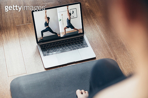 Young Woman Practising Yoga Workout With A Video Lesson On Laptop. - gettyimageskorea