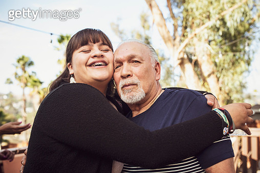 Granddaughter hugging grandfather - gettyimageskorea