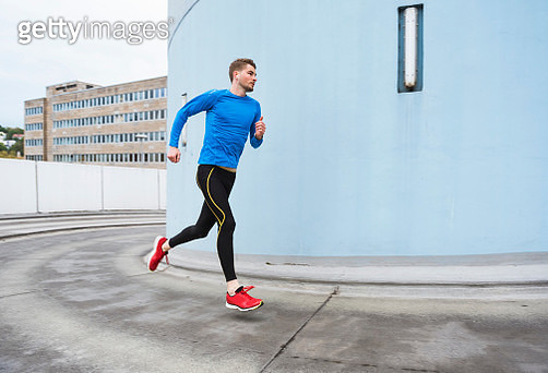 Young man running in the city - gettyimageskorea