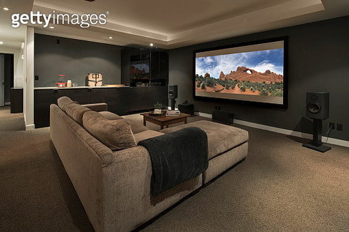 Movie playing on projection screen in home theater - gettyimageskorea