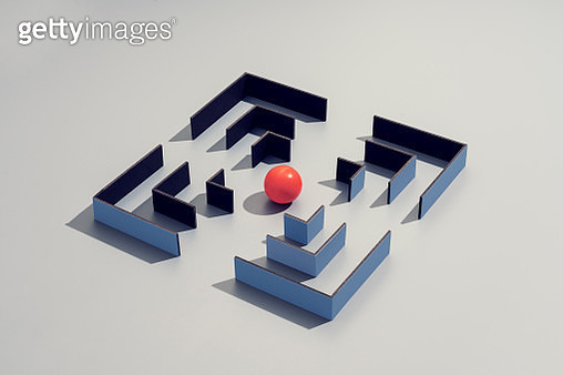 conceptual image of a maze with a red sphere in the center - gettyimageskorea