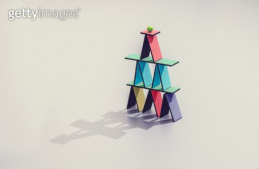 Colored card house with a marble on top - gettyimageskorea