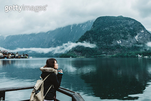Young woman walking along the lake - gettyimageskorea