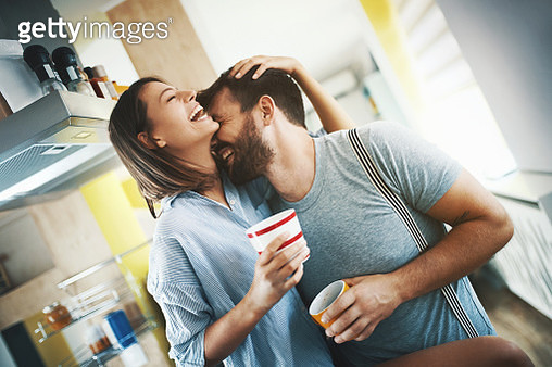 Couple having morning coffee at home. - gettyimageskorea
