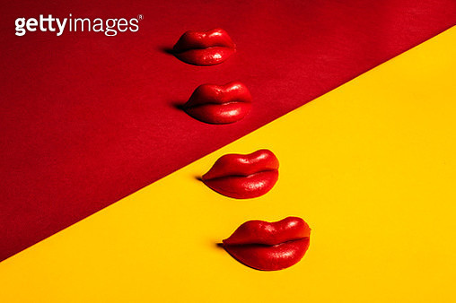Waxed Lips Against Yellow and Red Background, Graphic - gettyimageskorea