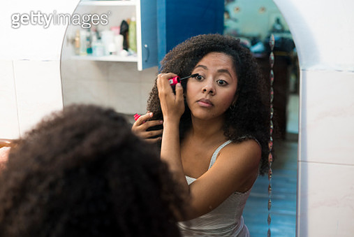 Woman getting ready in the bathroom - gettyimageskorea